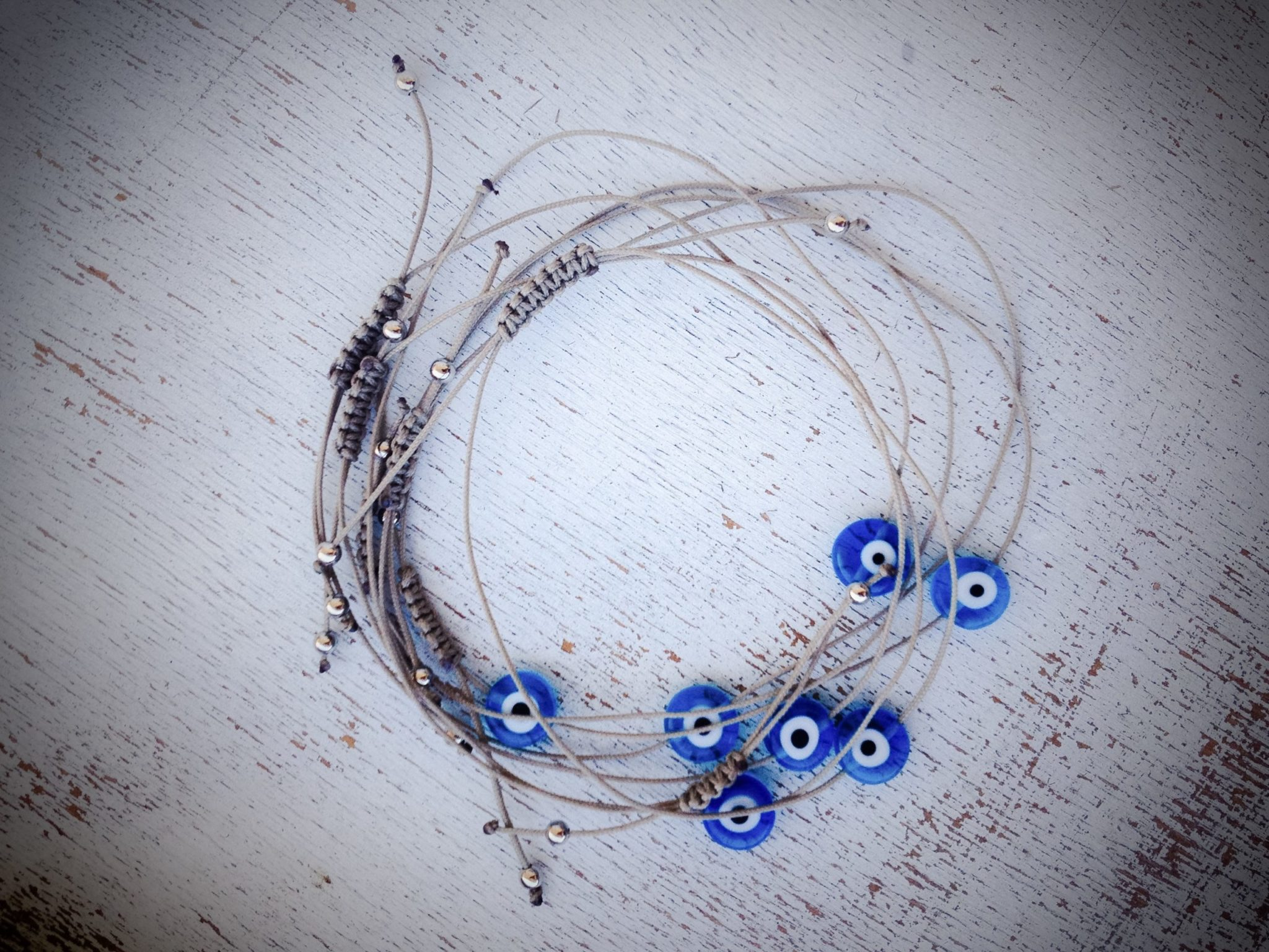 White Linen And Evil Eye-wedding favor-detail-bracelets