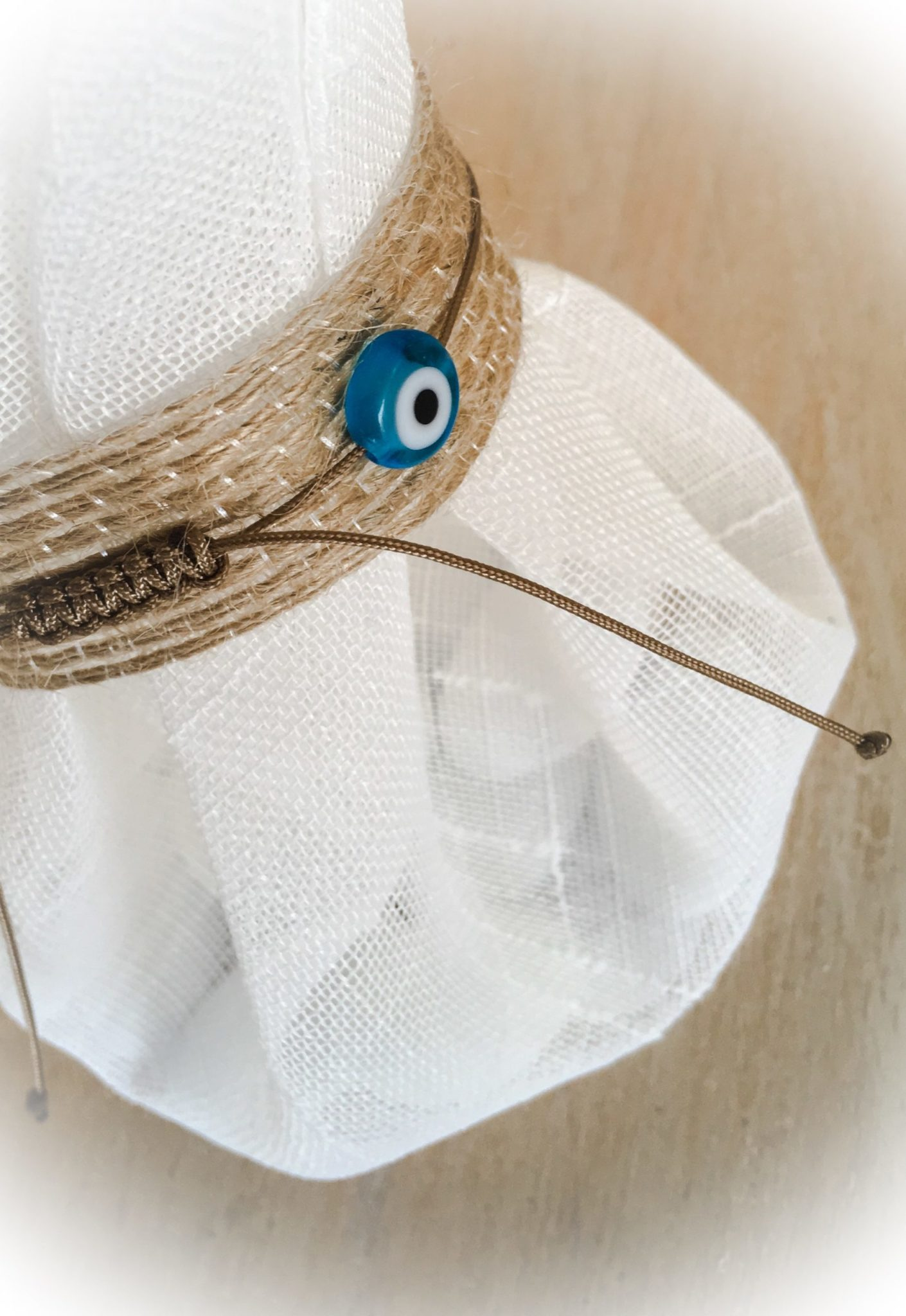 White Linen And Evil Eye-wedding favor-proposal b-close up